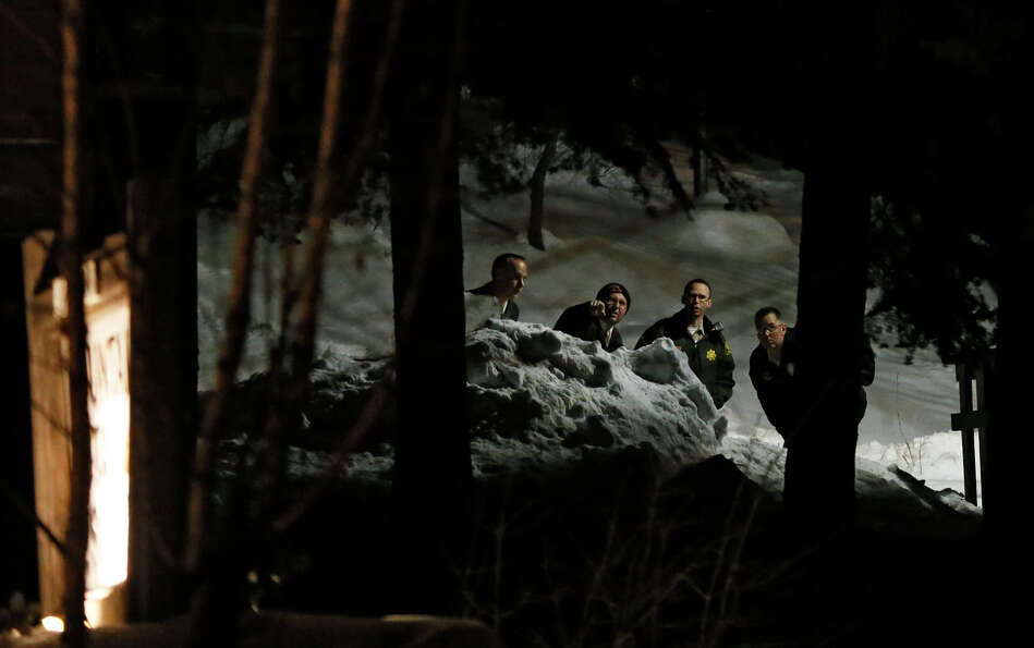 Investigators work near the Mountain View Resort in Big Bear, Calif., near where where authorities b