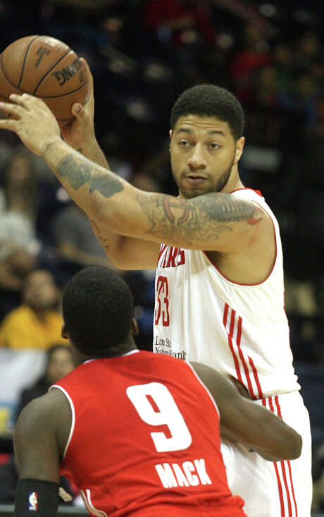 Royce White examines the defense while looking to pass off the ball. Photo: Joel Martinez