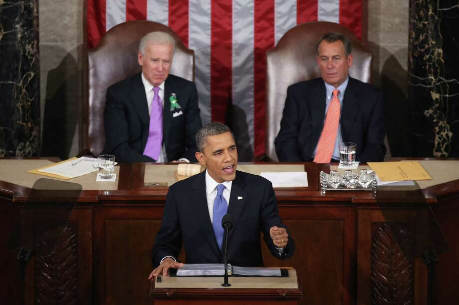 President Barack Obama delivers his address  flanked by Vice President Joe Biden and House Speaker John Boehner. Photo: Mark Wilson, Staff / 2013 Getty Images