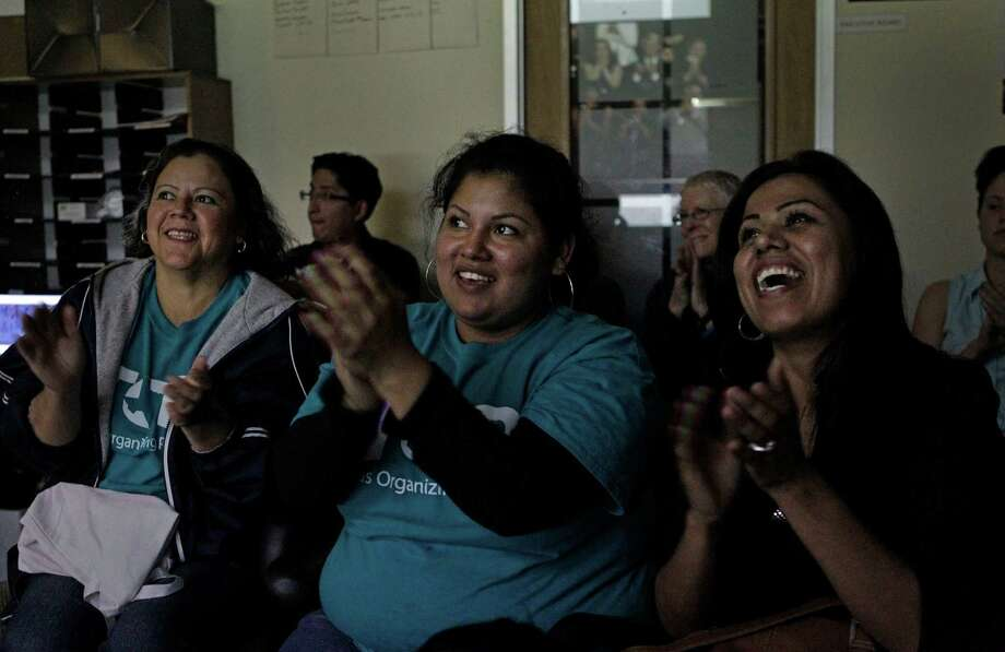 Graciela Maldonado, left, Zulema Perez and Maria Garcia applaud President Barack Obama's remarks about  immigration Tuesday at a watch party for the Houston for Commonsense Immigration Reform coalition. Photo: Melissa Phillip, Staff / © 2013 Houston Chronicle