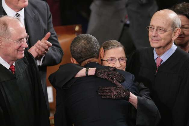 WASHINGTON, DC - FEBRUARY 12: Supreme Court Justice Ruth Bader Ginsburg hugs U.S. President Barack Obama before Obama delivered his State of the Union speech before a joint session of Congress at the U.S. Capitol February 12, 2013 in Washington, DC. Facing a divided Congress, Obama focused his speech on new initiatives designed to stimulate the U.S. economy and said, It's not a bigger government we need, but a smarter government that sets priorities and invests in broad-based growth. Also pictured (L-R) are Justice Anthony Kennedy and Justice John Paul Steven. Photo: Chip Somodevilla, Getty Images / 2013 Getty Images