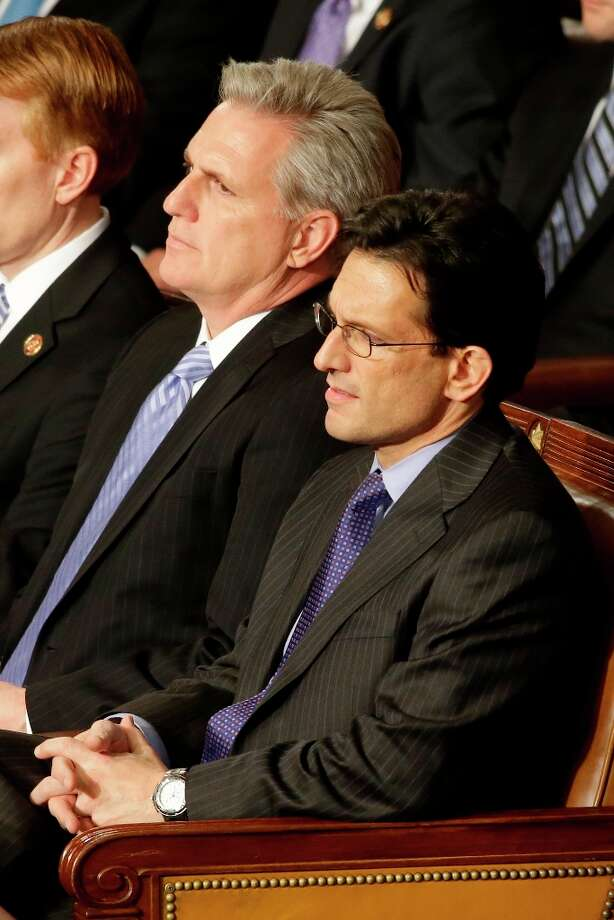 House Majority Whip Kevin McCarthy of Calif., left, and House Majority Leader Eric Cantor of Va. listen as President Barack Obama gives his State of the Union address during a joint session of Congress on Capitol Hill in Washington, Tuesday Feb. 12, 2013. (AP Photo/Jacquelyn Martin) Photo: Jacquelyn Martin, Associated Press / AP