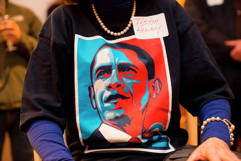 Tisha Kenny, of San Francisco, displays a Barack Obama watches t-shirt during a State of the Union watch party for President Obama's State of the Union address in San Francisco, Calif. on Tuesday, February 12, 2013. Photo: Stephen Lam, Special To The Chronicle / ONLINE_YES