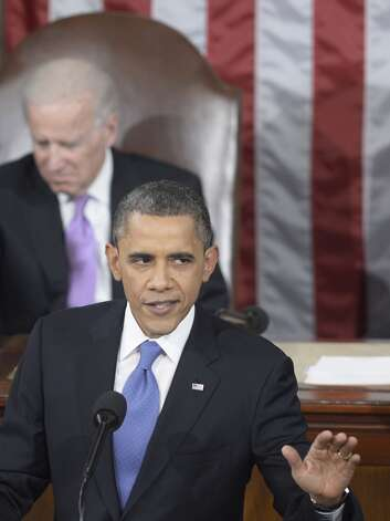 US President Barack Obama delivers the annual State of the Union address to a joint session of the US Congress in the House chamber on Capitol Hill February 12, 2012 in Washington, DC. AFP PHOTO/Brendan SMIALOWSKIBRENDAN SMIALOWSKI/AFP/Getty Images Photo: BRENDAN SMIALOWSKI, AFP/Getty Images / Brendan SMIALOWSKI
