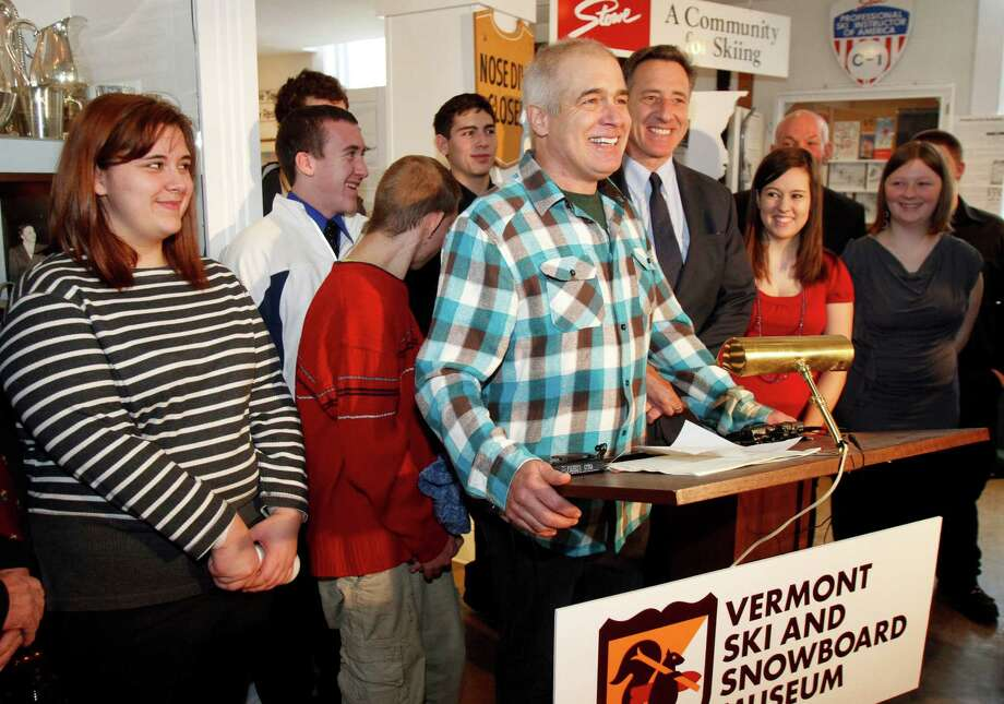 FILE - In this March 8, 2012 file photo, Jake Burton, the creator of Burton Snowboards, center, speaks during a bill signing with Gov. Peter Shumlin , on Burton's right, in Stowe, Vt. Recent studies by industry groups show snowboarding is no longer growing the way it was for its first 30 years. Burton, the man who perfected the modern-day snowboard and brought it to the masses back in the 1980s, recently sent a letter to his employees stating his concern about the trends but downplaying the well-circulated idea that snowboarding is losing its edge. (AP Photo/Toby Talbot, File) Photo: Toby Talbot