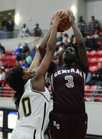 Lady Jaguar Rondaysha Thomas, #3, is fouled by Lady Bulldog Deja Alexander, #30, during the Class 4A first round playoff game featuring the Central High School Lady Jaguars and the Summer Creek High School Lady Bulldogs at Lee College in Baytown on Tuesday, February 12, 2013. Photo taken: Randy Edwards/The Enterprise Photo: Randy Edwards