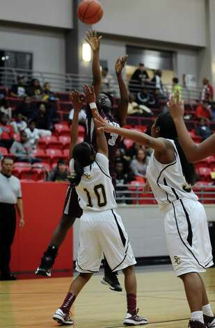Lady Jaguar Rondaysha Thomas, #3, puts it up for two during the Class 4A first round playoff game featuring the Central High School Lady Jaguars and the Summer Creek High School Lady Bulldogs at Lee College in Baytown on Tuesday, February 12, 2013. Photo taken: Randy Edwards/The Enterprise Photo: Randy Edwards