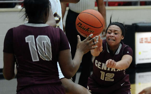 Lady Jaguar Tierra Douglas, #12, passes it to Courtney Bertrand, #10, during the Class 4A first round playoff game featuring the Central High School Lady Jaguars and the Summer Creek High School Lady Bulldogs at Lee College in Baytown on Tuesday, February 12, 2013. Photo taken: Randy Edwards/The Enterprise Photo: Randy Edwards