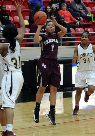 Lady Jaguar Malena Washington, #1, shoots for three during the Class 4A first round playoff game featuring the Central High School Lady Jaguars and the Summer Creek High School Lady Bulldogs at Lee College in Baytown on Tuesday, February 12, 2013. Photo taken: Randy Edwards/The Enterprise Photo: Randy Edwards