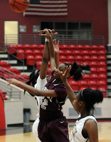 Lady Jaguar Sydney Larkins, #52, shoots for two during the Class 4A first round playoff game featuring the Central High School Lady Jaguars and the Summer Creek High School Lady Bulldogs at Lee College in Baytown on Tuesday, February 12, 2013. Photo taken: Randy Edwards/The Enterprise Photo: Randy Edwards