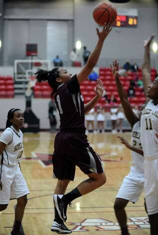 Lady Jaguar Malena Washington, #1, puts it up for two during the Class 4A first round playoff game featuring the Central High School Lady Jaguars and the Summer Creek High School Lady Bulldogs at Lee College in Baytown on Tuesday, February 12, 2013. Photo taken: Randy Edwards/The Enterprise Photo: Randy Edwards