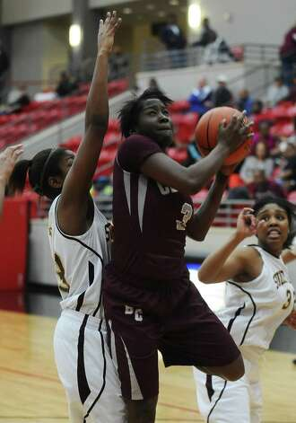 Lady Jaguar Rondaysha Thomas, #3, rebounds the ball during the Class 4A first round playoff game featuring the Central High School Lady Jaguars and the Summer Creek High School Lady Bulldogs at Lee College in Baytown on Tuesday, February 12, 2013. Photo taken: Randy Edwards/The Enterprise Photo: Randy Edwards