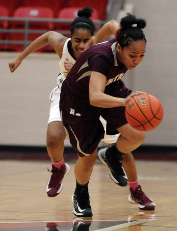 Lady Jaguar Malena Washington, #1, steals the ball from Lady Bulldog Sugar Young, #34, during the Class 4A first round playoff game featuring the Central High School Lady Jaguars and the Summer Creek High School Lady Bulldogs at Lee College in Baytown on Tuesday, February 12, 2013. Photo taken: Randy Edwards/The Enterprise Photo: Randy Edwards