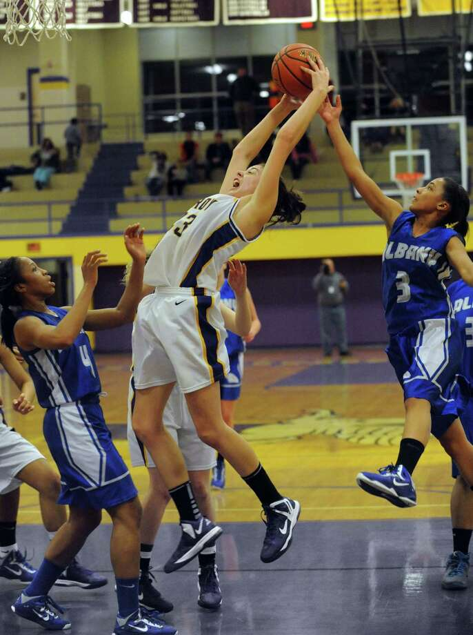 Troy's Krystyn Knockwood grabs a defensive rebound during their game against Albany High on Tuesday Feb. 12, 2013 in Troy, N.Y. .(Michael P. Farrell/Times Union) Photo: Michael P. Farrell