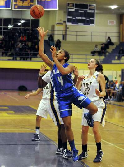 Albany High's Emia Willingham-Hurst goes to the basket during their game against Troy on Tuesday Feb