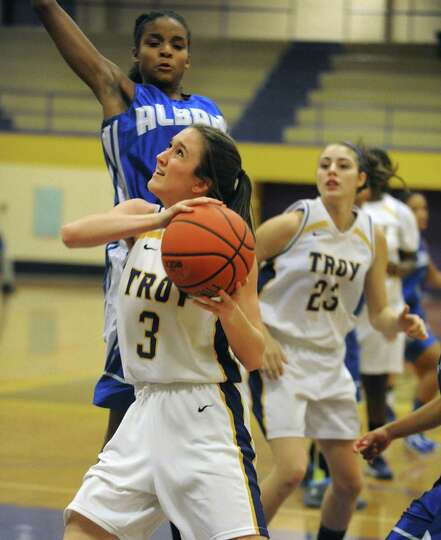 Troy's Mary Pattison drives to the basket during their game against Albany High on Tuesday Feb. 12,