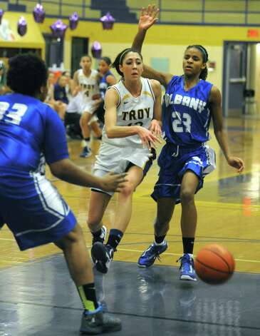 Troy's Courtney Avery passes the ball during their game against Albany High on Tuesday Feb. 12, 2013 in Troy, N.Y. .(Michael P. Farrell/Times Union) Photo: Michael P. Farrell