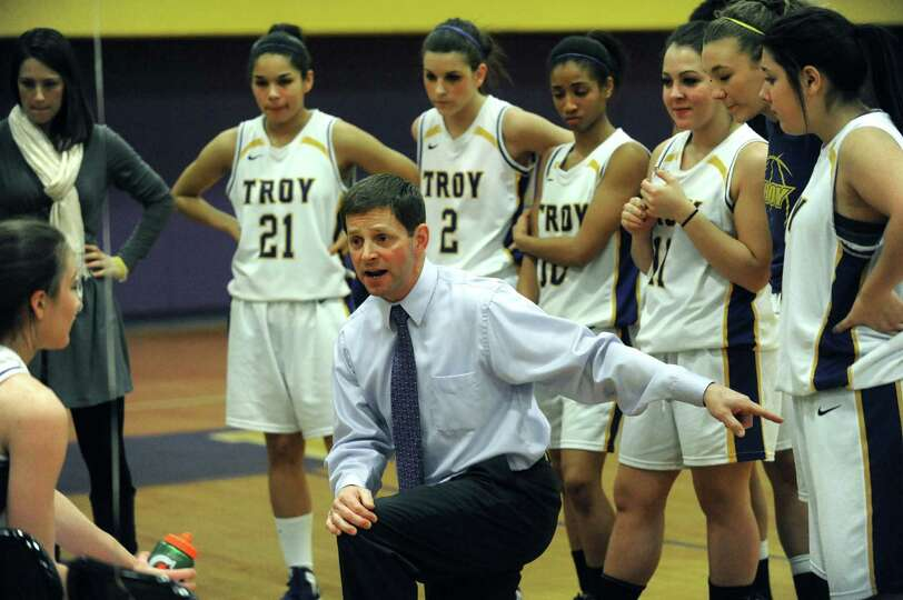 Troy head coach Paul Bearup talks with his team during their game against Albany High on Tuesday Feb