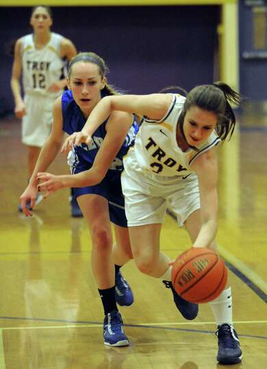 Troy's Mary Pattison and Albany's Cara Waterson battle for a loose ball during their girl's high sch