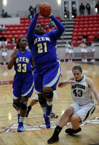 Lady Panther Nekia Jones, #21, puts it up for two during the Class 4A first round playoff game featuring the Ozen High School Lady Panthers and the Kingwood Park High School Lady Panthers at Lee College in Baytown on Tuesday, February 12, 2013. Photo taken: Randy Edwards/The Enterprise