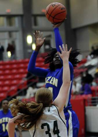 Lady Panther SanQueisha Rawls, #10, puts it up for two during the Class 4A first round playoff game featuring the Ozen High School Lady Panthers and the Kingwood Park High School Lady Panthers at Lee College in Baytown on Tuesday, February 12, 2013. Photo taken: Randy Edwards/The Enterprise Photo: Randy Edwards