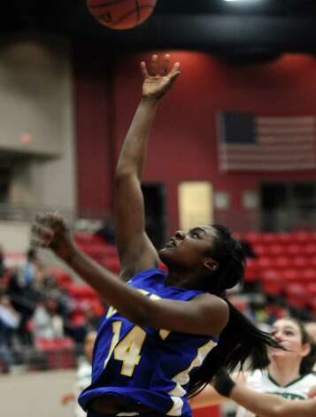 Lady Panther Bealoved Brown, #14, puts it up for two during the Class 4A first round playoff game featuring the Ozen High School Lady Panthers and the Kingwood Park High School Lady Panthers at Lee College in Baytown on Tuesday, February 12, 2013. Photo taken: Randy Edwards/The Enterprise Photo: Randy Edwards