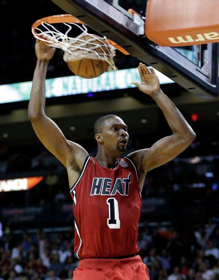 Miami Heat's Chris Bosh (1) scores against the Portland Trail Blazers during the first half of an NBA basketball game in Miami, Tuesday, Feb. 12, 2013. (AP Photo/Alan Diaz) Photo: Alan Diaz