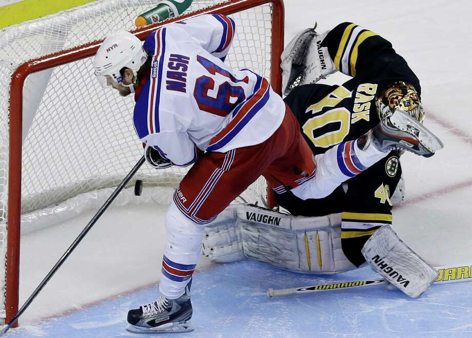 New York Rangers left wing Rick Nash (61) scores past Boston Bruins goalie Tuukka Rask (40) during a shootout of an NHL hockey game in Boston, Tuesday, Feb. 12, 2013. The Rangers won 4-3. (AP Photo/Elise Amendola) Photo: Elise Amendola