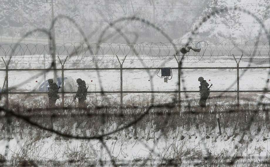 South Korean army soldiers patrol along barbed-wire fences at the Imjingak Pavilion, near the demilitarized zone of Panmunjom, in Paju, South Korea, Tuesday, Feb. 12, 2013. South Korea is confirming that North Korea has tested a nuclear device in defiance of U.N. orders to stop building atomic weapons. (AP Photo/Ahn Young-joon) Photo: Ahn Young-joon, Associated Press