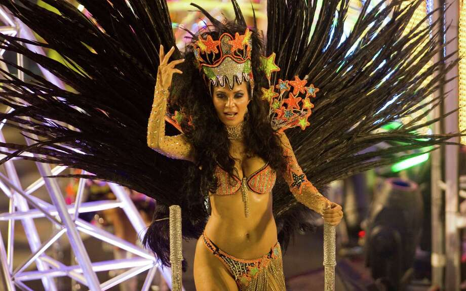 A reveler of Imperatriz Leopoldinense samba school performs during the second night of Carnival parade at the Sambadrome in Rio de Janeiro, Brazil on February 12, 2013.  AFP PHOTO/ANTONIO SCORZA Photo: ANTONIO SCORZA, Getty / 2013 AFP