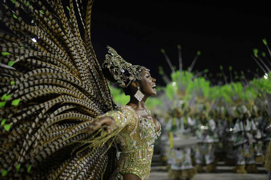 A reveler of Imperatriz Leopoldinense samba school performs during the second night of Carnival parades at the Sambadrome in Rio de Janeiro on February 12, 2013.      AFP PHOTO / CHRISTOPHE SIMON Photo: Getty