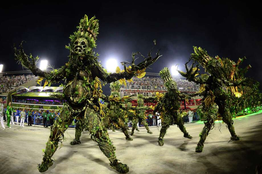 Revelers of Imperatriz Leopoldinense samba school perform during the second night of Carnival parades at the Sambadrome in Rio de Janeiro on February 12, 2013.      AFP PHOTO / CHRISTOPHE SIMON Photo: Getty