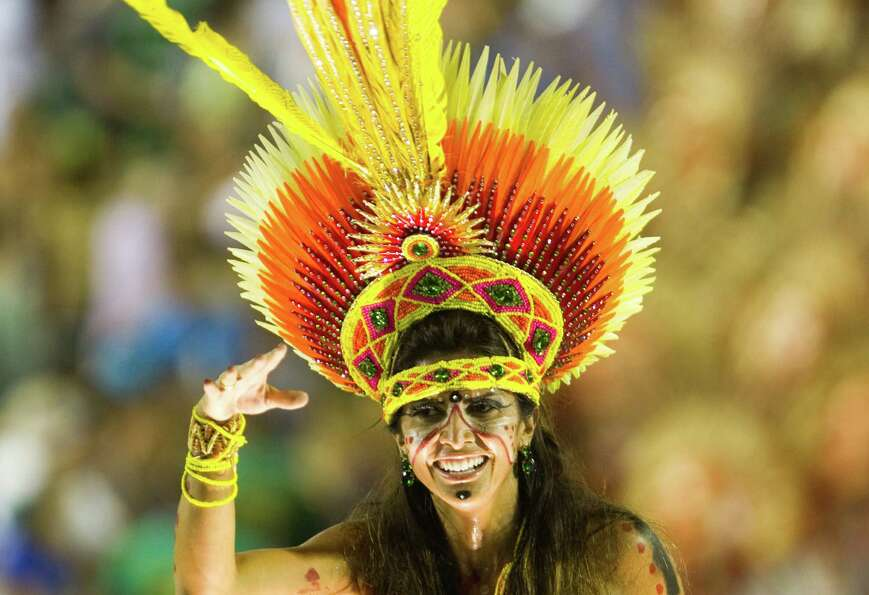 A reveler of Imperatriz Leopoldinense samba school performs during the second night of Carnival para