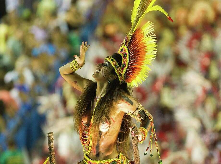 A reveler of Imperatriz Leopoldinense samba school performs during the second night of Carnival parade at the Sambadrome in Rio de Janeiro, Brazil on February 12, 2013.  AFP PHOTO/ANTONIO SCORZA Photo: ANTONIO SCORZA, Getty / 2013 AFP