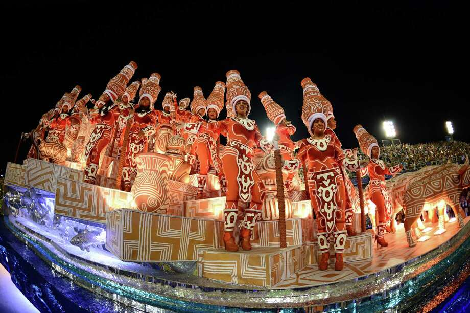 Revelers of Imperatriz Leopoldinense samba school perform atop a float during the second night of Carnival parades at the Sambadrome in Rio de Janeiro on February 12, 2013.      AFP PHOTO / CHRISTOPHE SIMON Photo: Getty