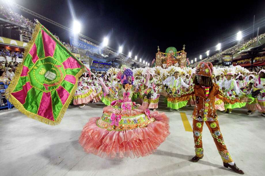 Members of Mangueira Samba School  give a show during the parade themed on Cuiaba, capital city of Mato Grosso at Sambodrome Sapucai as part of Carnival 2013 on February 12, 2013 in Rio de Janeiro, Brazil. Photo: Getty