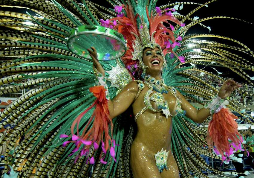 A dancer of Mangueira Samba School performs during the parade themed on Cuiaba, capital city of Mato