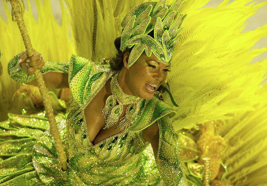 A reveler of Vila Isabel samba school performs during the second night of Carnival parade at the Sambadrome in Rio de Janeiro, Brazil on February 12, 2013.  AFP PHOTO/ANTONIO SCORZA Photo: ANTONIO SCORZA, Getty / 2013 AFP
