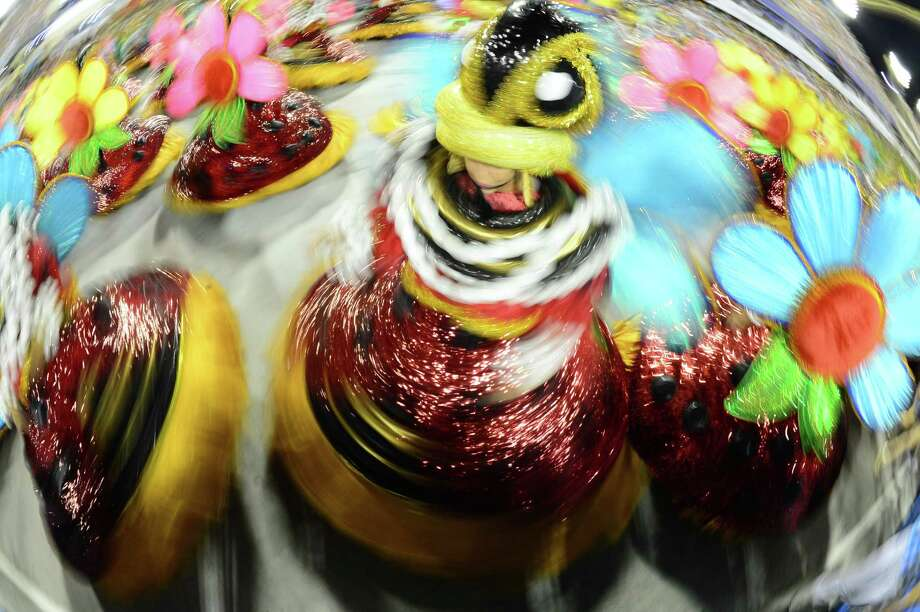 Revelers of Vila Isabel samba school perform during the second night of Carnival parades at the Sambadrome in Rio de Janeiro on February 12, 2013.      AFP PHOTO / CHRISTOPHE SIMON Photo: Getty