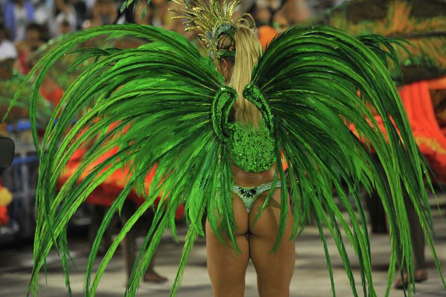 A reveler of Vila Isabel samba school performs during the second night of Carnival parades at the Sambadrome in Rio de Janeiro on February 12, 2013.      AFP PHOTO / CHRISTOPHE SIMON Photo: Getty