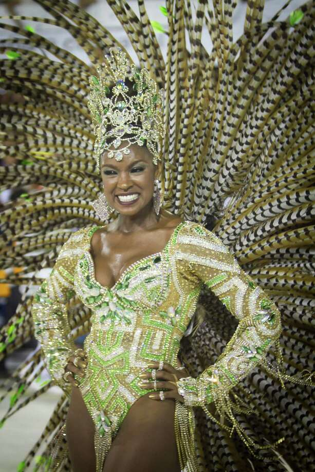 Members of Imperatriz Leopoldinense Samba School perform during Carnival 2013 at Sambodrome Sapucai on February 12, 2013 in Rio de Janeiro, Brazil. The Samba School parade is features on the Amazonas. Photo: Getty
