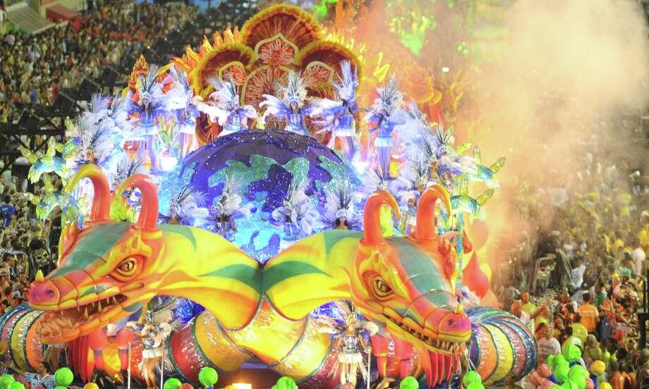 Revelers of Vila Isabel samba school perform during the second night of Carnival parade at the Sambadrome in Rio de Janeiro, Brazil on February 12, 2013.  AFP PHOTO/ANTONIO SCORZA Photo: Getty