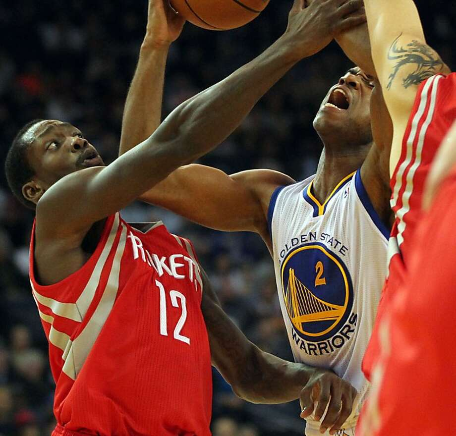 Golden State Warriors guard Jarrett Jack (2) is fouled by Houston Rockets Patrick Beverley (12) in the first half of their NBA basketball game Tuesday, February 13, 2013. in Oakland Calif. Photo: Lance Iversen, The Chronicle
