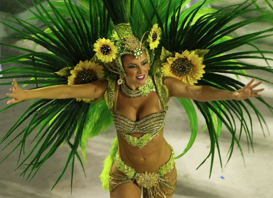 A dancer from Rio de Janeiro's samba school Vila Isabel performs along the Sambadrome on the second day of the traditional city's samba school parade on February 12, 2013.    AFP  PHOTO ANTONIO SCORZA Photo: ANTONIO SCORZA, Getty / 2013 AFP