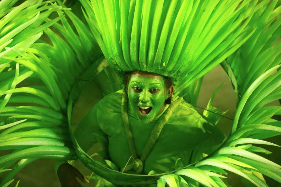 A dancer from Rio de Janeiro's samba school Vila Isabel performs along the Sambadrome on the second day of the traditional city's samba school parade on February 12, 2013.    AFP  PHOTO ANTONIO SCORZA Photo: ANTONIO SCORZA, Getty / 2013 AFP