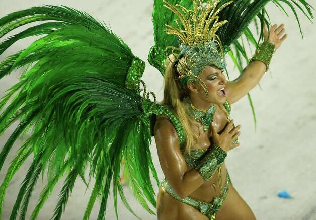 A dancer from Rio de Janeiro's samba school Vila Isabel performs along the Sambadrome on the second day of the traditional city's samba school parade on February 12, 2013.    AFP  PHOTO A