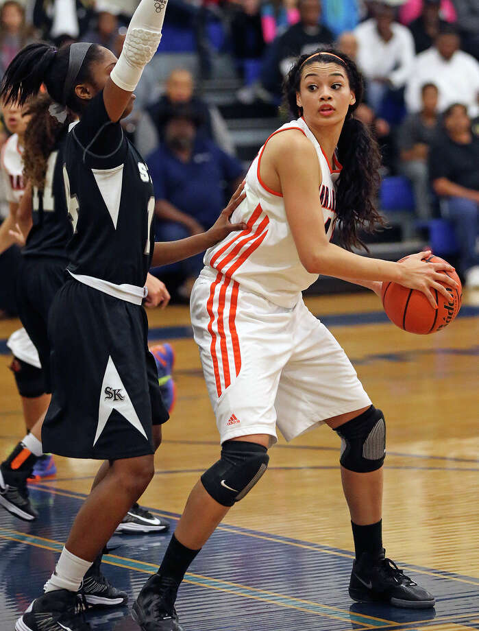 Bronco center Morgan Williams looks for a cutting teammate as  Steele plays Brandeis at Alamo Heights gym on February 12, 2013. Photo: Tom Reel, San Antonio Express-News