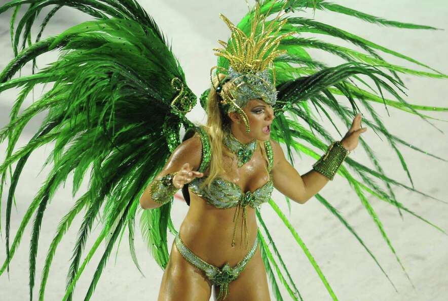 A reveler of Vila Isabel samba school performs during the second night of Carnival parade at the Sam