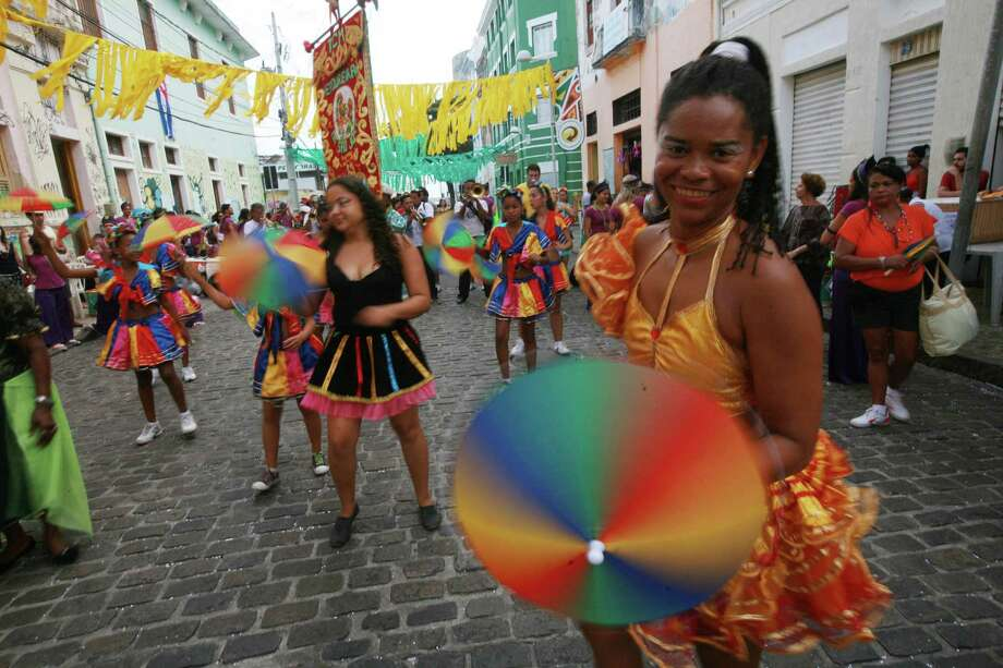 Revelers enjoy the parade followed by thousands of people during the Carnival on February 12, 2013 in Olinda, Brazil Photo: Getty