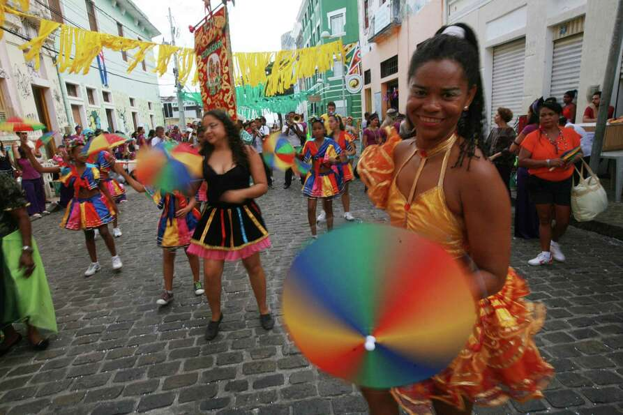 Revelers enjoy the parade followed by thousands of people during the Carnival on February 12, 2013 i
